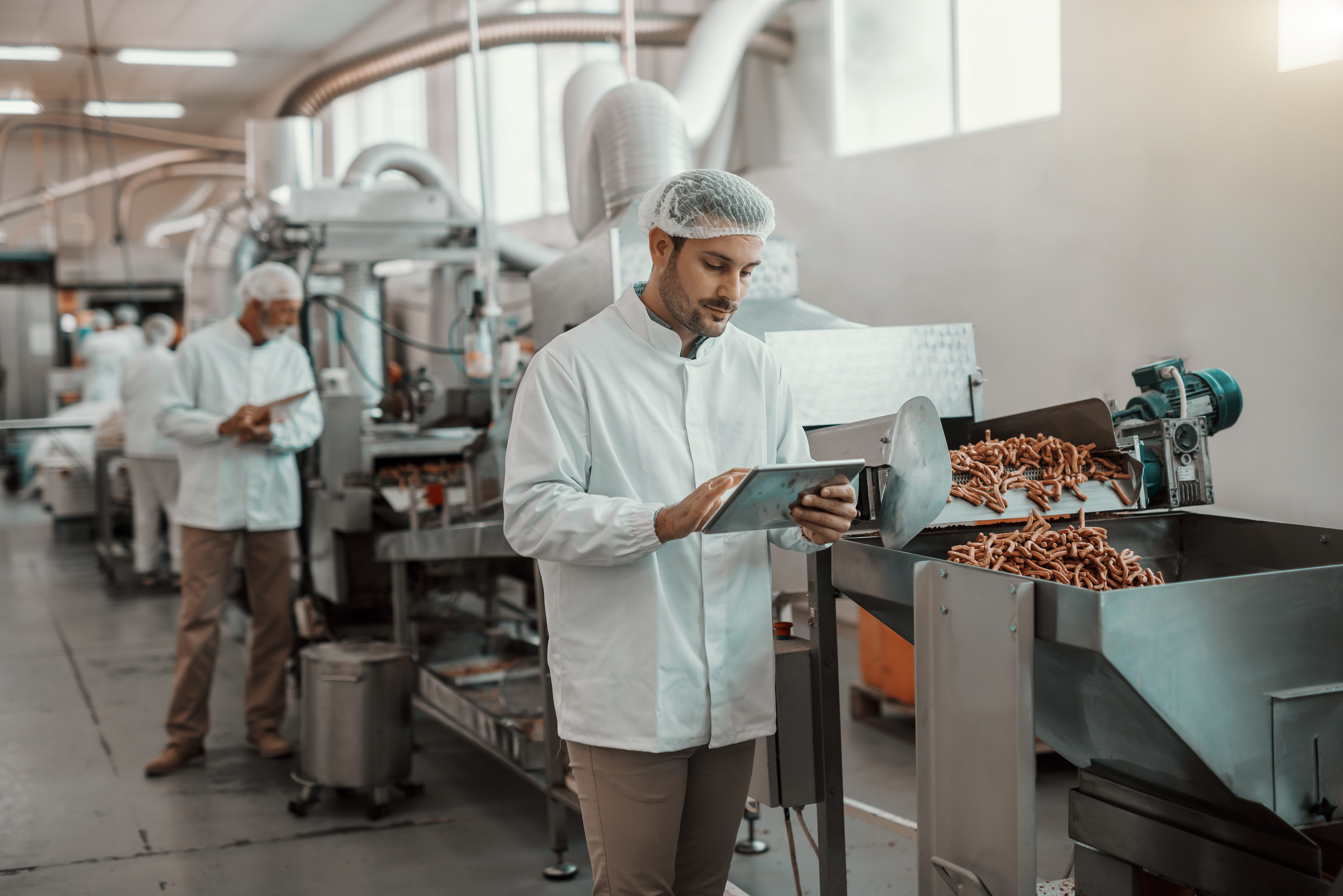 man working in food manufacturing plant